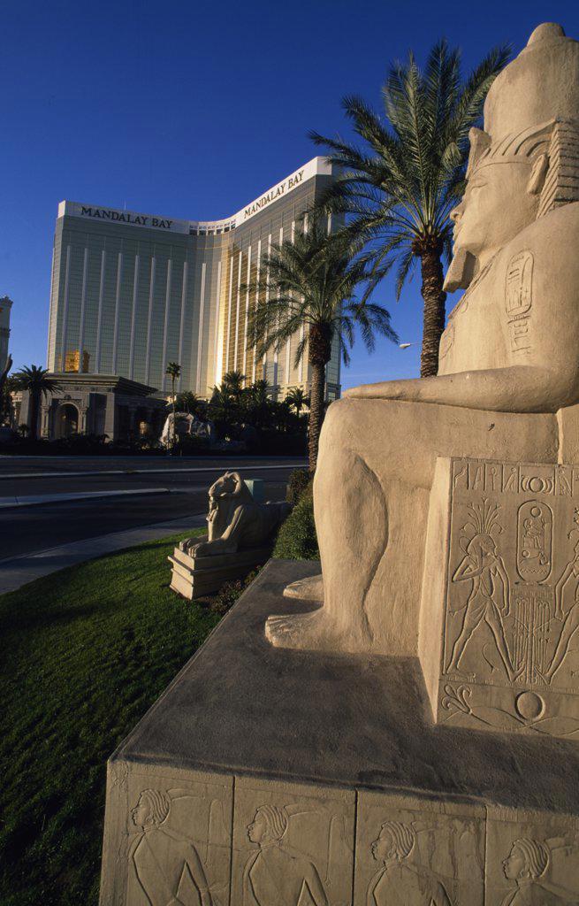Stock Photo: 1486-8255 USA, Nevada, Las Vegas, Egyptian style statue and modern building