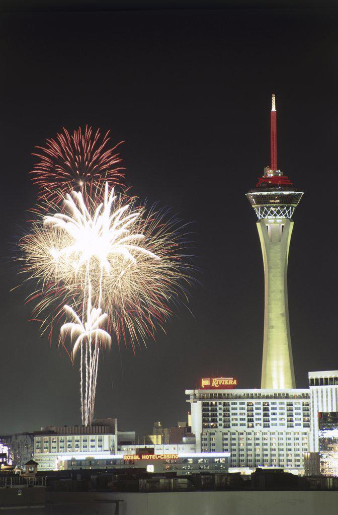 Stock Photo: 1486-8342 Low angle view of firework display in the sky, Stratosphere Las Vegas, Las Vegas, Nevada, USA