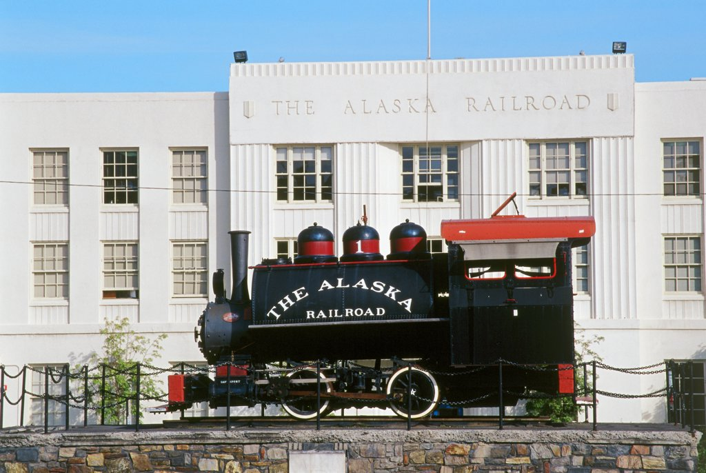 Stock Photo: 1486-8761 Model of an antique train engine in front of a building, The Alaska Railroad, Anchorage, Alaska, USA