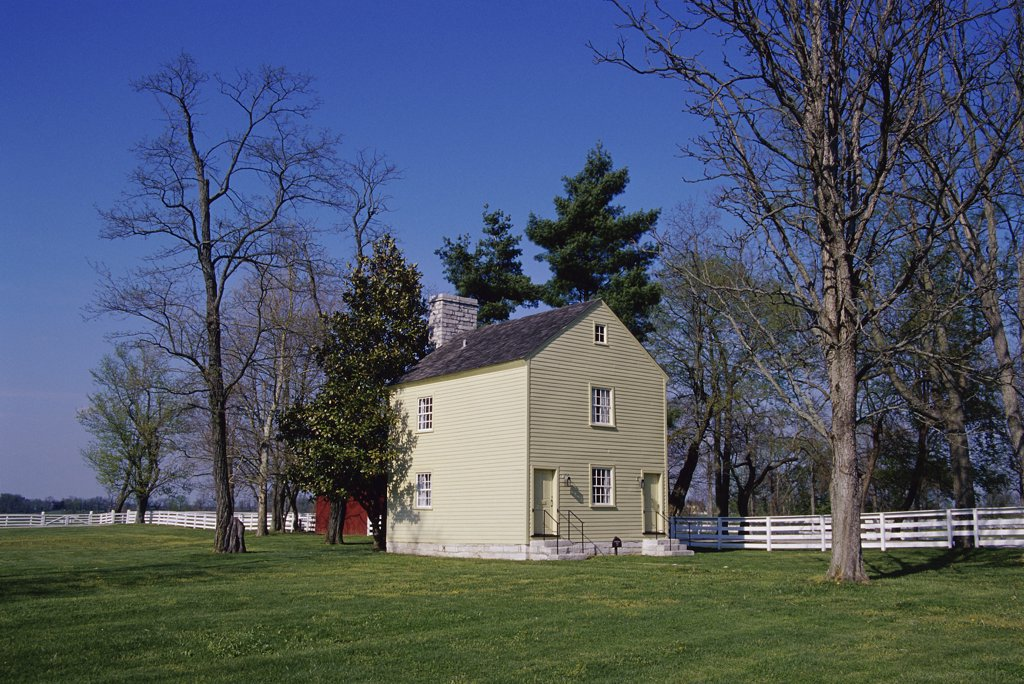 Stock Photo: 1486-9400 Facade of a building in a field, Shaker Village, Pleasant Hill, Kentucky, USA