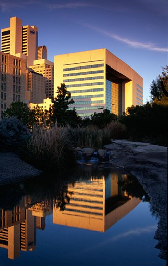 Stock Photo: 1486-977 Reflection of buildings in a lake, Dallas, Texas, USA