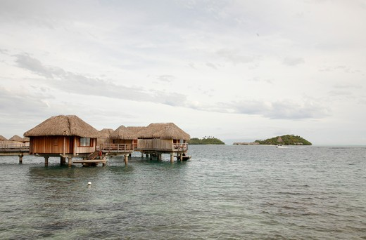 Stilt houses in pacific ocean, Bora Bora, Tahiti, French Polynesia : Stock Photo