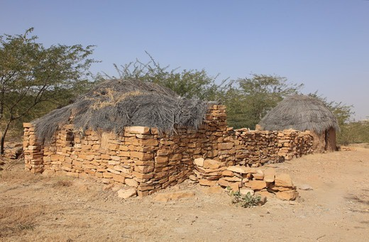 India, Rajahstan, Jaisalmer, House and animal enclosure : Stock Photo