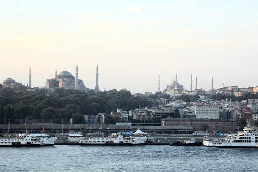 Stock Photo: 1488-793 Early morning view of a harbor with the Blue Mosque and Hagia Sophia in the background, Istanbul, Turkey