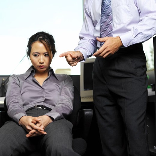 Stock Photo: 1491R-01069 businessman reprimanding colleague in office low angle view