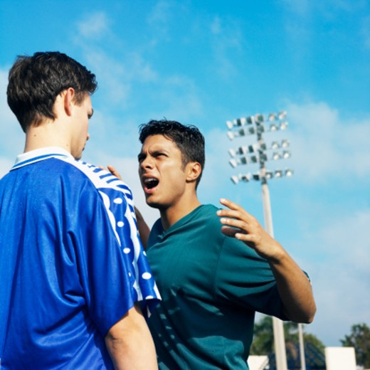Stock Photo: 1491R-01080 two male soccer players (16-20) arguing