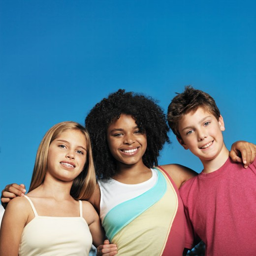 Stock Photo: 1491R-01150 portrait of teenagers (14-18) arms around each other