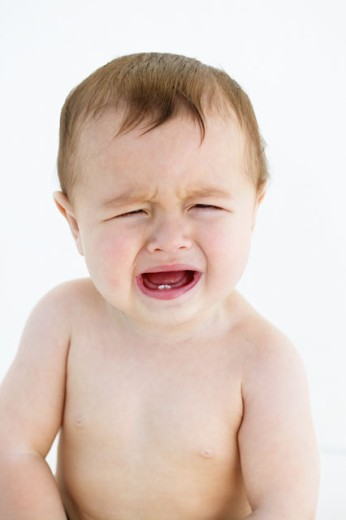 close up view of a baby (12-18 months) crying : Stock Photo