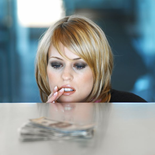 Stock Photo: 1491R-0153 businesswoman watching and tempted by American dollar bills on the table