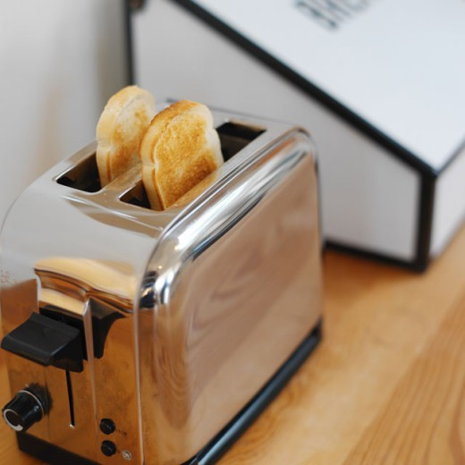elevated view of a toaster with toast in it : Stock Photo
