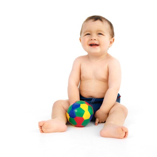 Stock Photo: 1491R-01730 baby (12-18 months) playing with a toy