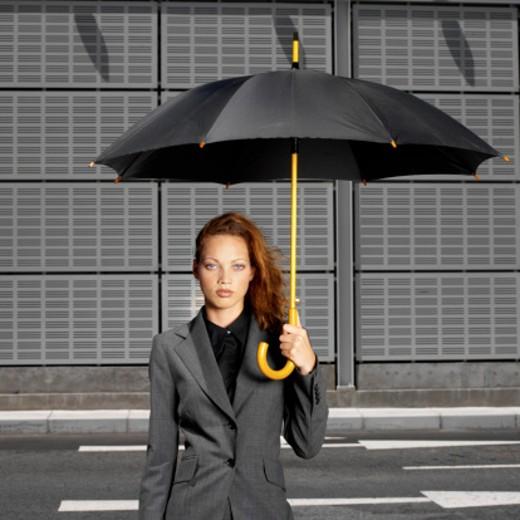 Stock Photo: 1491R-0212 businesswoman outdoors holding umbrella