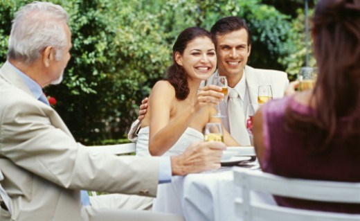 newlywed couple raising a toast at a wedding reception : Stock Photo