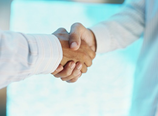 Stock Photo: 1491R-02361 two businessmen shaking hands