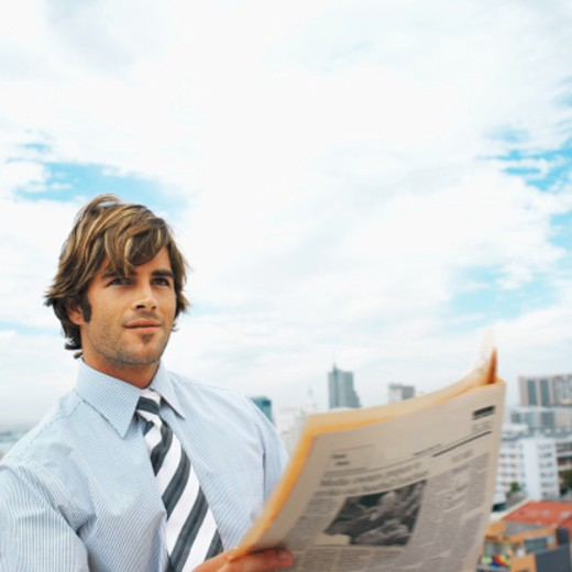 close up of businessman reading newspaper : Stock Photo