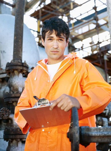 Stock Photo: 1491R-02704 mechanic holding a clipboard