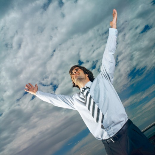 Stock Photo: 1491R-0304 close up of businessman raising his hands with delight