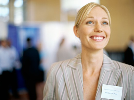 Stock Photo: 1491R-03091 close-up of a businesswoman smiling at an exhibition