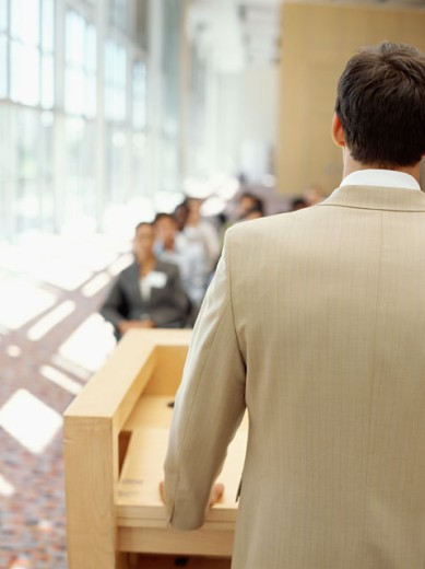 businessman giving presentation to a group of business executives at a seminar : Stock Photo