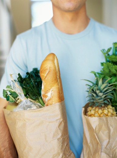 Stock Photo: 1491R-04215 close-up of a man holding grocery bags