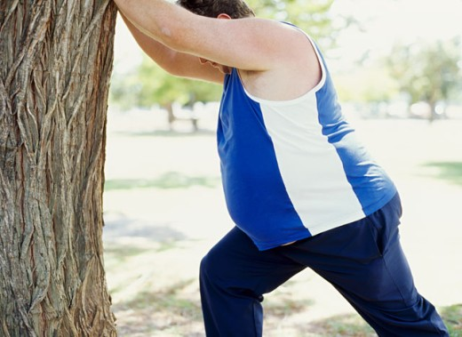 side profile of a mid adult man exercising in a park : Stock Photo
