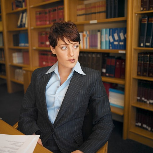 Stock Photo: 1491R-0583 close up of businesswoman sitting at desk anxiously completing an aptitude test