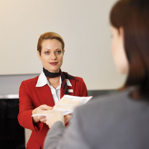 Stock Photo: 1491R-0630 close up of businesswoman checking in and stewardess checking ticket
