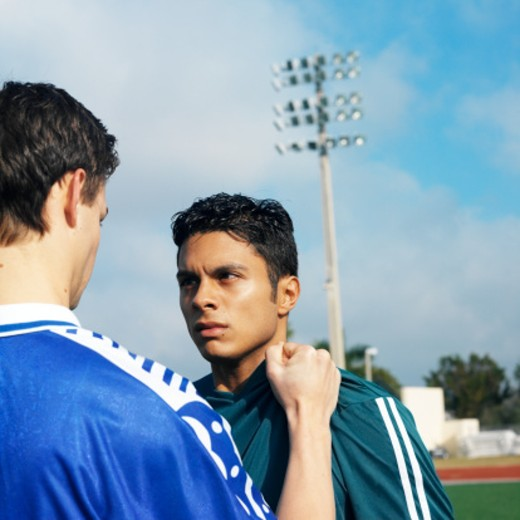 confrontation between two male (16-20) soccer players : Stock Photo