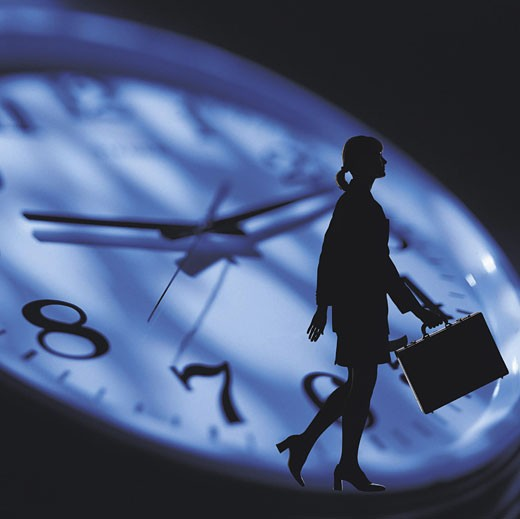 Stock Photo: 1491R-1014021 Female with briefcase against clock face