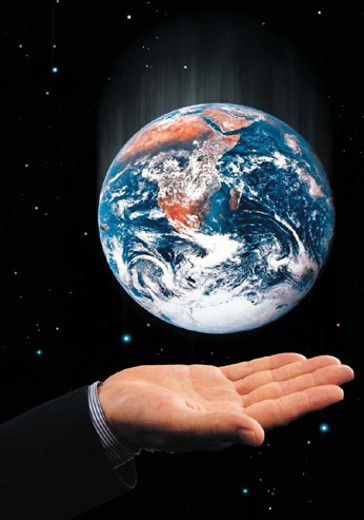 Outstretched palm either earth or globe above starry background : Stock Photo