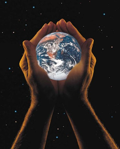 Stock Photo: 1491R-1014041 Hands holding the earth, starry background