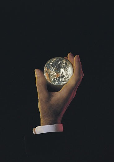 Male hand holding earth or globe : Stock Photo