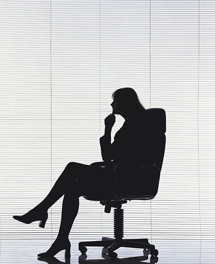 Stock Photo: 1491R-1014823 Female sitting on office chair