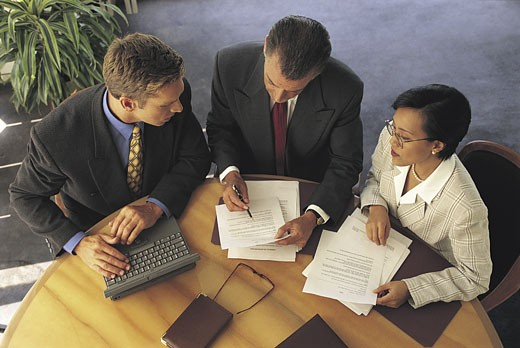 Multicultural business discussion : Stock Photo