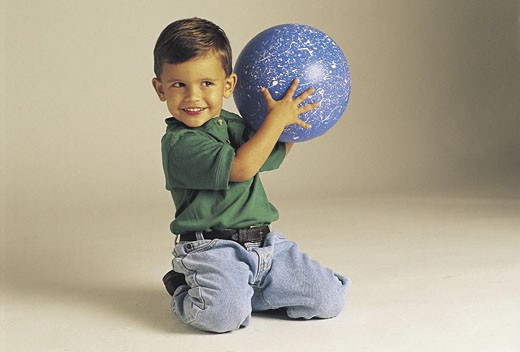 Stock Photo: 1491R-1015095 White boy playing with ball