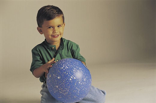 Stock Photo: 1491R-1015096 White boy playing with ball