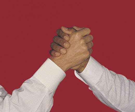 Arm wrestle, high handshake, business men, red background : Stock Photo