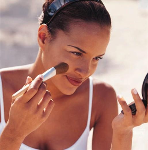 Woman Applying Blusher : Stock Photo