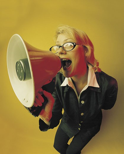 Woman Shouting down a Megaphone : Stock Photo