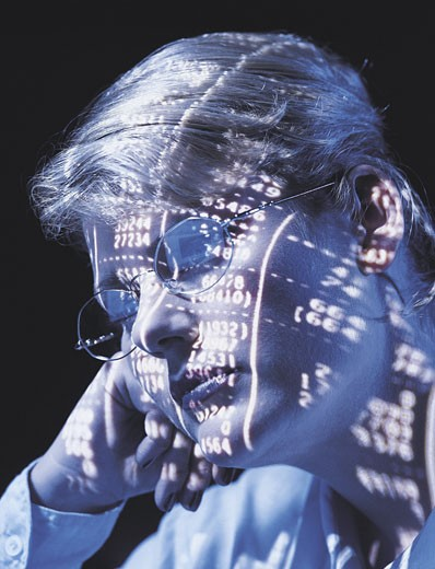 Woman with Numbers Projected on her Face : Stock Photo