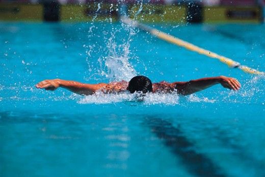 Swimmer doing the Butterfly Stroke : Stock Photo