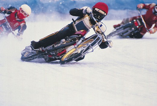Motorcycle racers on snow : Stock Photo