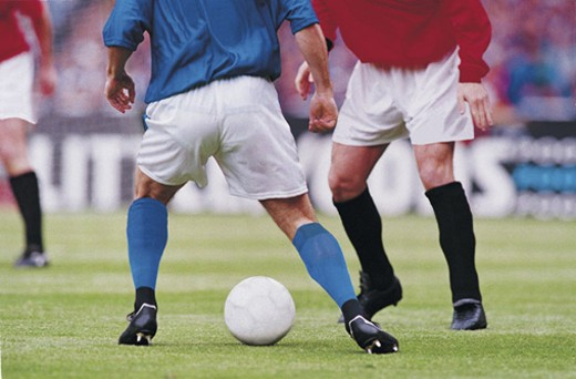 Soccer players on field : Stock Photo