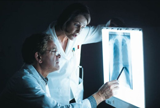 Stock Photo: 1491R-1016641 Doctors Examining thoracic Xray