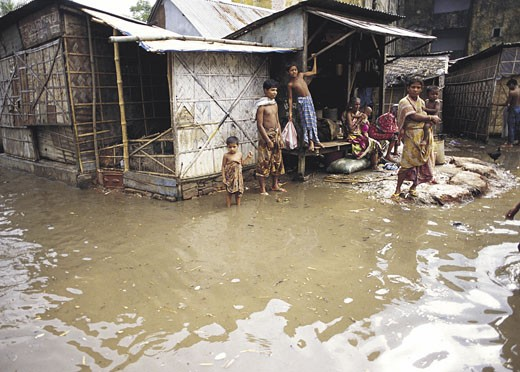 Floodwaters surrounding houses in Dhaka,Bangladesh : Stock Photo