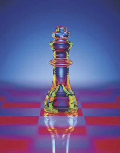 Multicolored Chess Piece on Checkerboard : Stock Photo