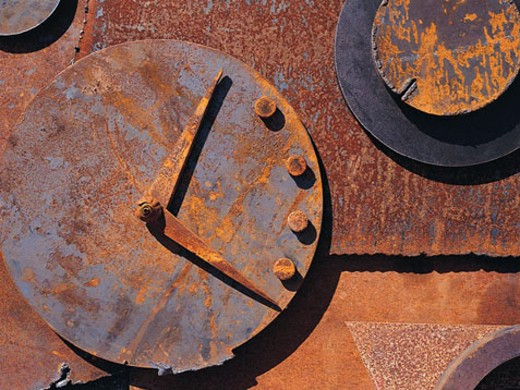 Stock Photo: 1491R-1017973 Rusted metal clock abstraction
