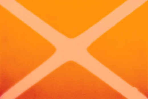 White X on orange background : Stock Photo