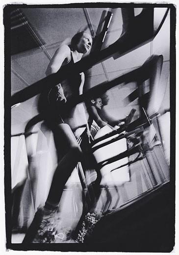 Stock Photo: 1491R-1018723 Woman walking on treadmill