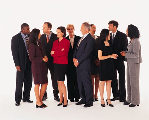 Business people standing in casual group, chatting : Stock Photo